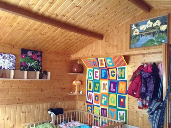 moth orchids, 2014 & an alphabet quilt from Marmalade's great-godmother, Diane Savona, hanging up on our bedroom wall